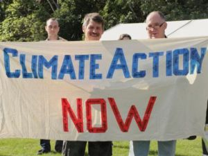 "Activists with sign: ""climate action now"""