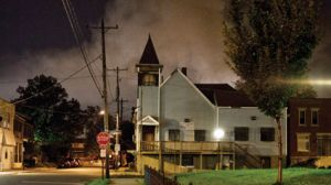 Burning row houses behind a church in Columbus, Ohio.