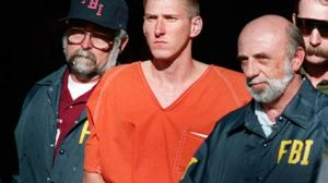 Photo of Timothy McVeigh being escorted from the Perry oklahoma courthouse.