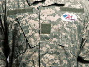 Soldier with voting sticker crossed out
