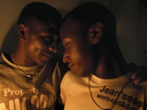 A couple at a gay bar in Kampala.