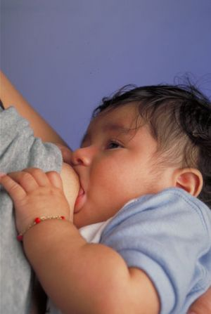 403px-Breastfeeding_infant.jpg