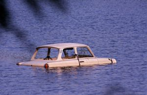 Car in a pond.