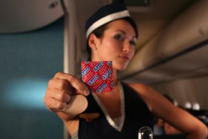 stewardess with condom