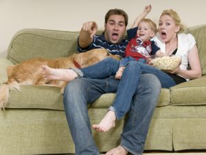 family watching movie on couch