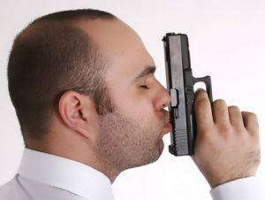 man kissing gun