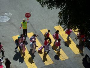 kids crossing with guard