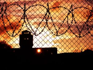 prison barbed wire sunset