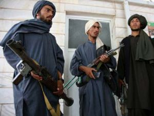 former Taliban insurgents with weapons