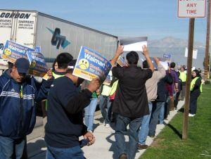 Warehouse workers picketing outside Schneider facilities