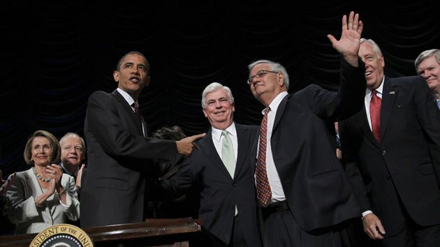 President Obama with Chris Dodd and Barney Frank after signing the bill.