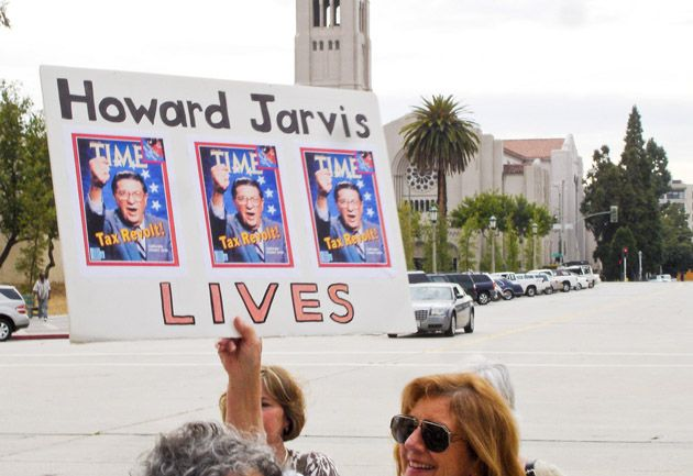 "a sign that says ""Howard Jarvis lives"""