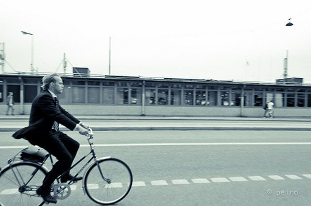 Man in suit on bike