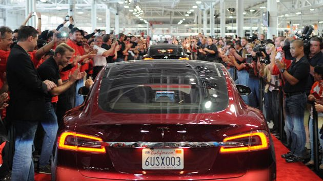 Model S and people cheering