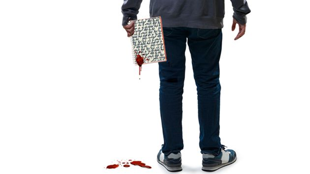 man holding bloody notebook