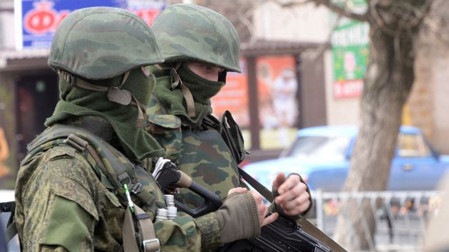 Russian troops, in uniforms without insignia, continue to surround Ukrainian mil