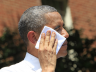 President Obama wipes his face during a speech on climate change at Georgetown U