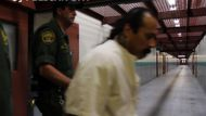 Pelican Bay prisoner is escorted by guards.
