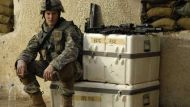 A soldier sitting on crates